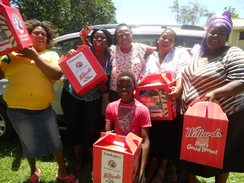 Busi and the Etete Team with the hampers